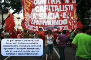 A giant banner at the World Social Forum, with the hammer and sickle representing communism, calls for the end of capitalism and the institution of communism.